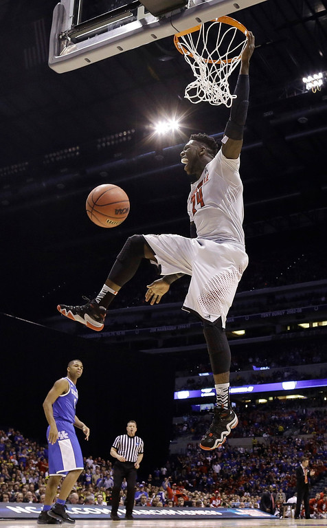 . Louisville\'s Montrezl Harrell dunks during the first half of an NCAA Midwest Regional semifinal college basketball tournament game against the Kentucky Friday, March 28, 2014, in Indianapolis. (AP Photo/David J. Phillip)
