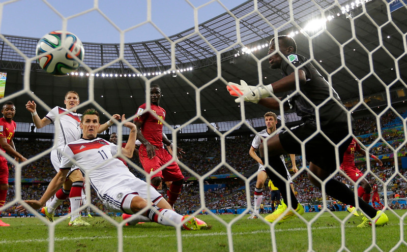 . Germany\'s Miroslav Klose, center, scores his side\'s second goal during the group G World Cup soccer match between Germany and Ghana at the Arena Castelao in Fortaleza, Brazil, Saturday, June 21, 2014. (AP Photo/Frank Augstein)