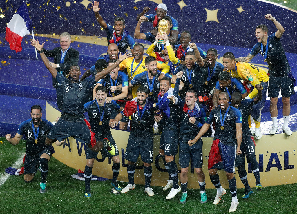 . France goalkeeper Hugo Lloris holds the trophy aloft after the final match between France and Croatia at the 2018 soccer World Cup in the Luzhniki Stadium in Moscow, Russia, Sunday, July 15, 2018. France won the final 4-2. (AP Photo/Frank Augstein)