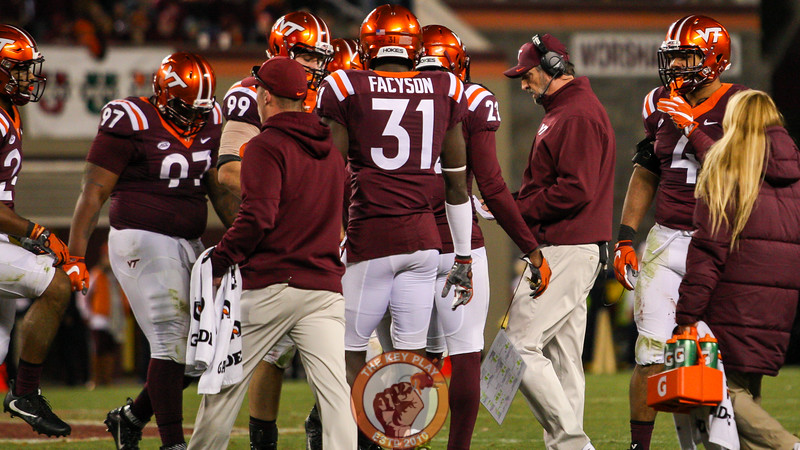 Virginia Tech defensive coordinator Bud Foster looks at his play sheet as the Hokies prepare to go back out on defense. (Mark Umansky/TheKeyPlay.com)