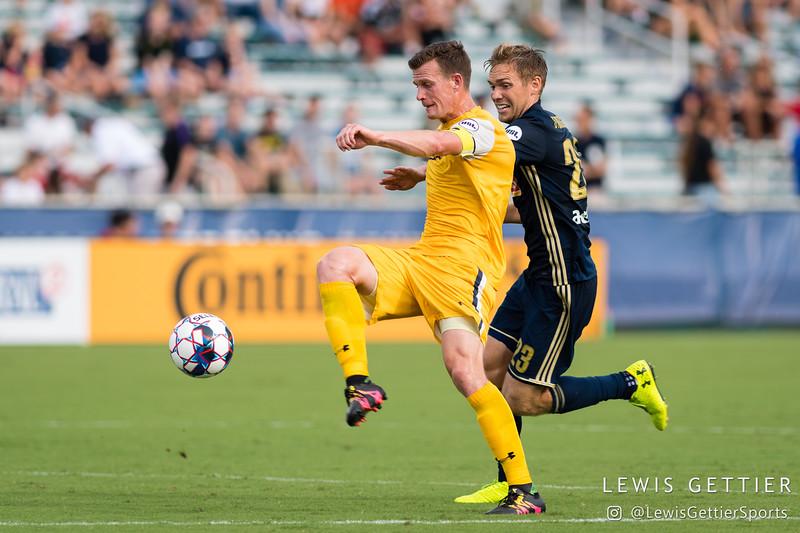 Nashville SC midfielder Michael Reed (17) and North Carolina FC midfielder Zach Steinberger (23)