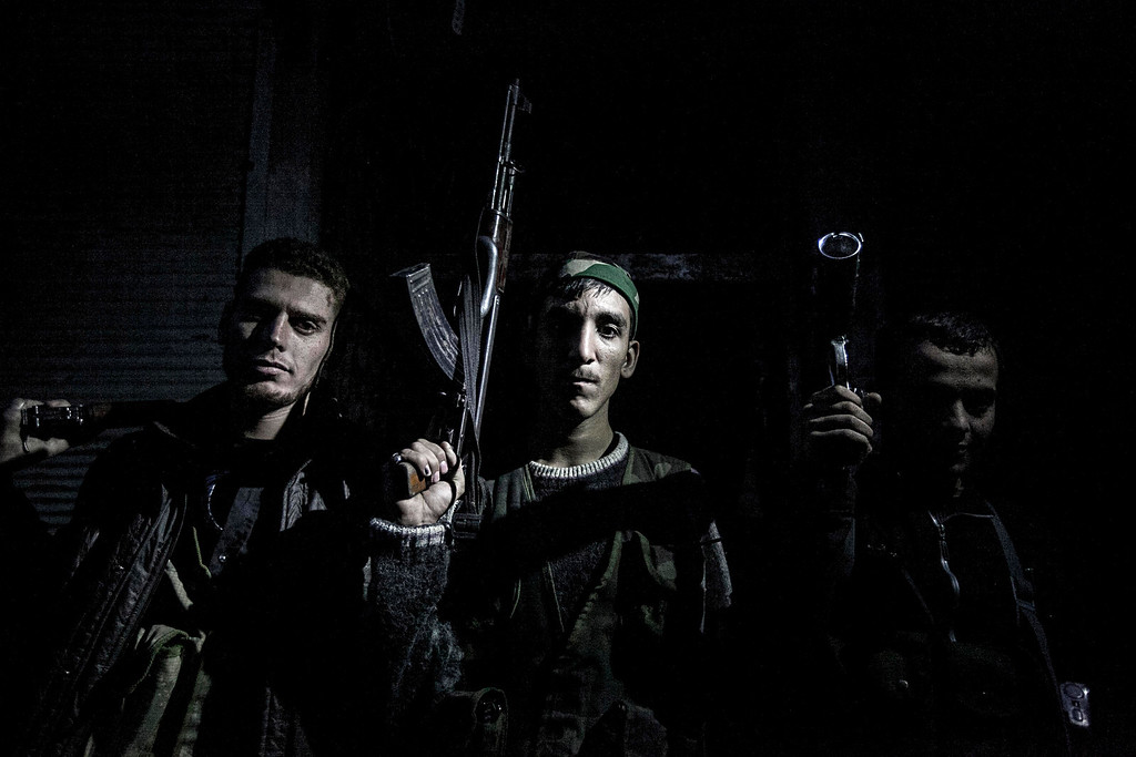 . FILE - Syrian rebel fighters belonging to the Liwa Al Tawhid unit pose for photo in the Karmal Jabl neighborhood after several days of intense clashes between rebel fighters and the Syrian army in Aleppo, Syria on Thursday, Oct. 25, 2012. (AP Photo/Narciso Contreras, File)