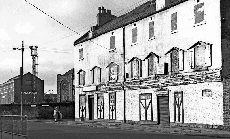 Orr St, west side at Crownpoint Rd.   The pub was The Crofters. Part of the former St Mary's Calton Primary School (where Glasgow Metropolitan College now teaches furniture craft) can be seen. The Graham building was the former West St Weaving Mill (the former name for that part of Kerr St was West St).    January 1974