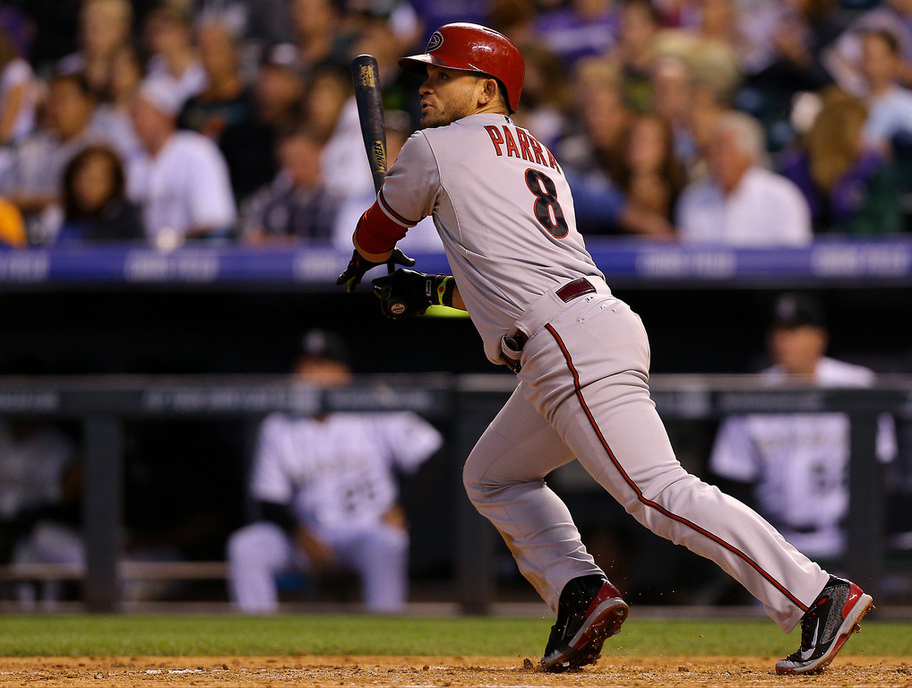 . Gerardo Parra #8 of the Arizona Diamondbacks hits an RBI double in the sixth inning against the Colorado Rockies at Coors Field on June 5, 2014 in Denver, Colorado.  (Photo by Justin Edmonds/Getty Images)
