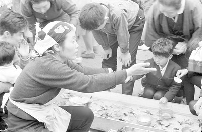 Japanese vendor selling pet fish to the kids-Tokyo 1965