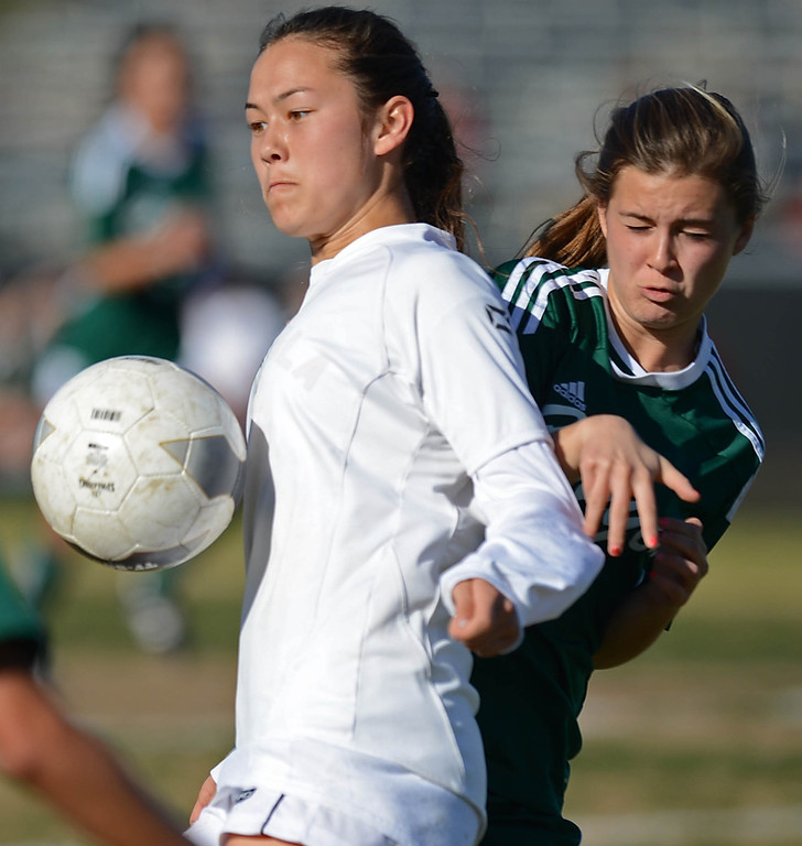 . Peninsula\'s Erika Okuma (19) takes control of the ball against Canyon\'s Hanna Halstead (6) in a CIF SS Division II first round soccer game Thursday in Rolling Hills Estates. After Peninsula seemingly dominated most of the game, Canyon scored a goal in the final two minutes to win 1-0. 20130214 Photo by Steve McCrank / Staff Photographer