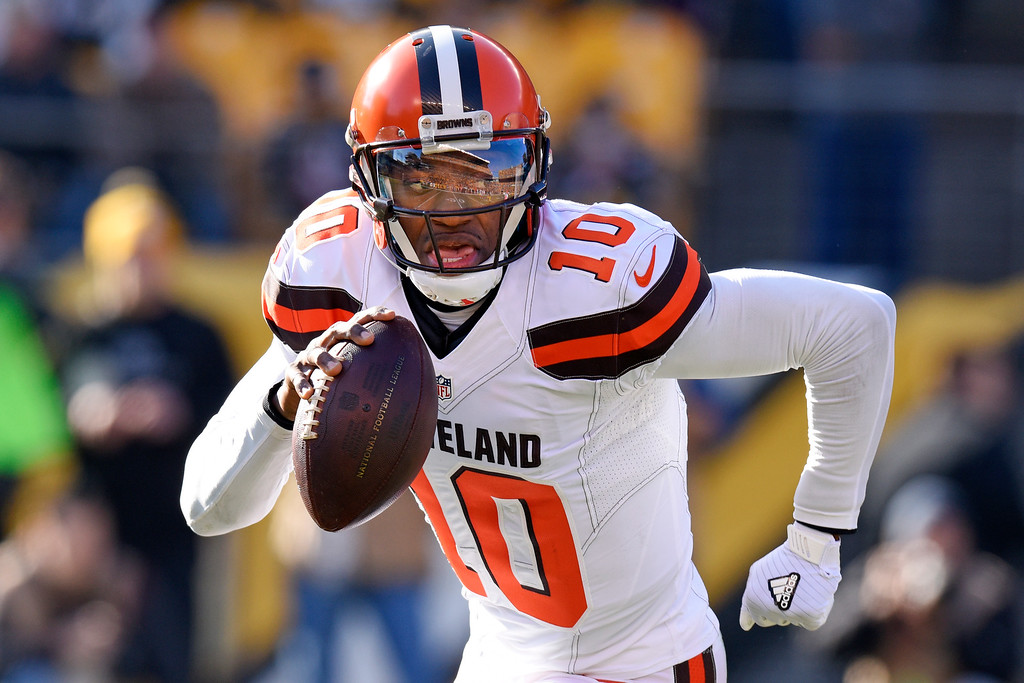 . Cleveland Browns quarterback Robert Griffin III (10) rolls out as he looks to pass during the first half of an NFL football game against the Pittsburgh Steelers in Pittsburgh, Sunday, Jan. 1, 2017. (AP Photo/Don Wright)