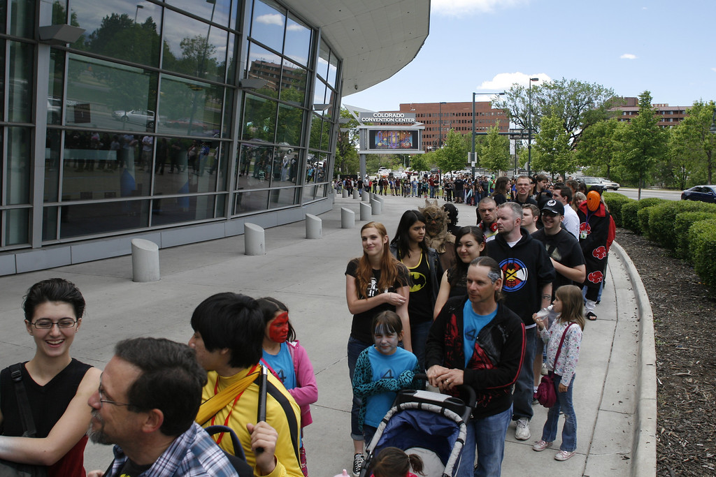 . DENVER, COLORADO - JUNE 1: Thousands form a line that wraps almost all the way around the Convention Center awaiting entry for Denver Comic Con on Saturday, June 1, 2013. By 11:45 a.m. the crowd had reached capacity for the day and ticket sales stopped. The Denver Comic Con is at the Colorado Convention Center May 31 through June 2, 2013. (Photo by Daniel J. Schneider/The Denver Post)