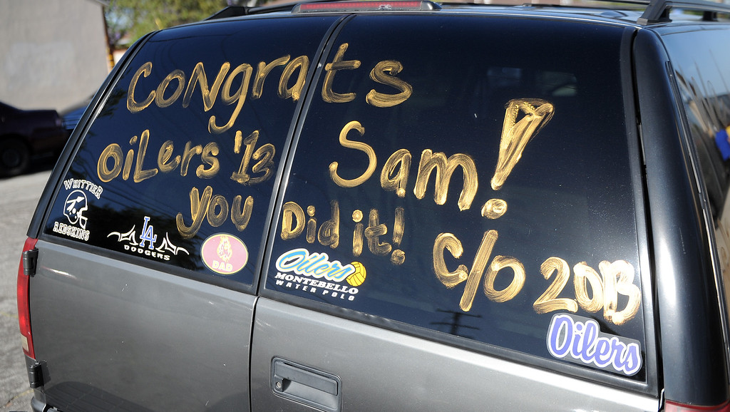 ". A note for ""Sam\"" on a truck during the Montebello High School commencement at Montebello High School on Thursday, June 20, 2013 in Montebello, Calif.  (Keith Birmingham/Pasadena Star-News)"