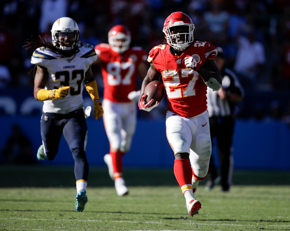 . Kansas City Chiefs running back Kareem Hunt, right, scores against the Los Angeles Chargers during the second half of an NFL football game, Sunday, Sept. 24, 2017, in Carson, Calif. (AP Photo/Jae C. Hong)