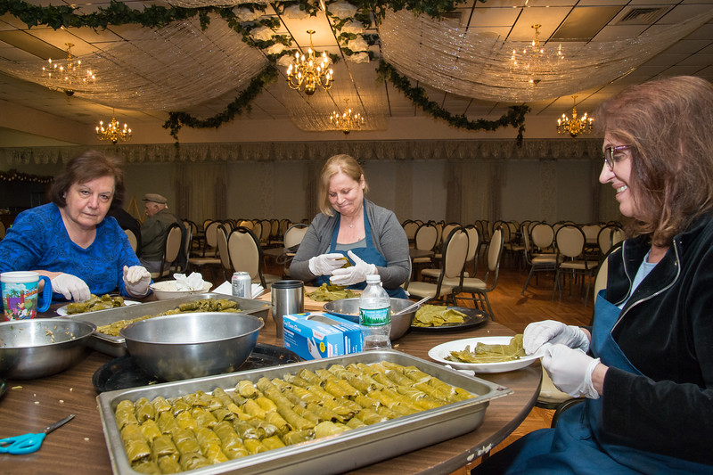 05/09/19  Wesley Bunnell | Staff  Evanthina Tsakopoulos, L, Stamo Dimitratos and Jenny Loukopoulos prepare trays of freshly made stuffed grape leaves on Thursday afternoon for the upcoming Dionysis Festival at St. Georges Greek Orthodox Church on 5/17-5/19.