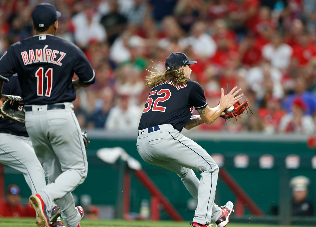. Cleveland Indians starting pitcher Mike Clevinger (52), fields a bunt off the bat of Cincinnati Reds\' Homer Bailey for a force out at first, during the fourth inning of a baseball game, Monday, Aug. 13, 2018, in Cincinnati. (AP Photo/Gary Landers)