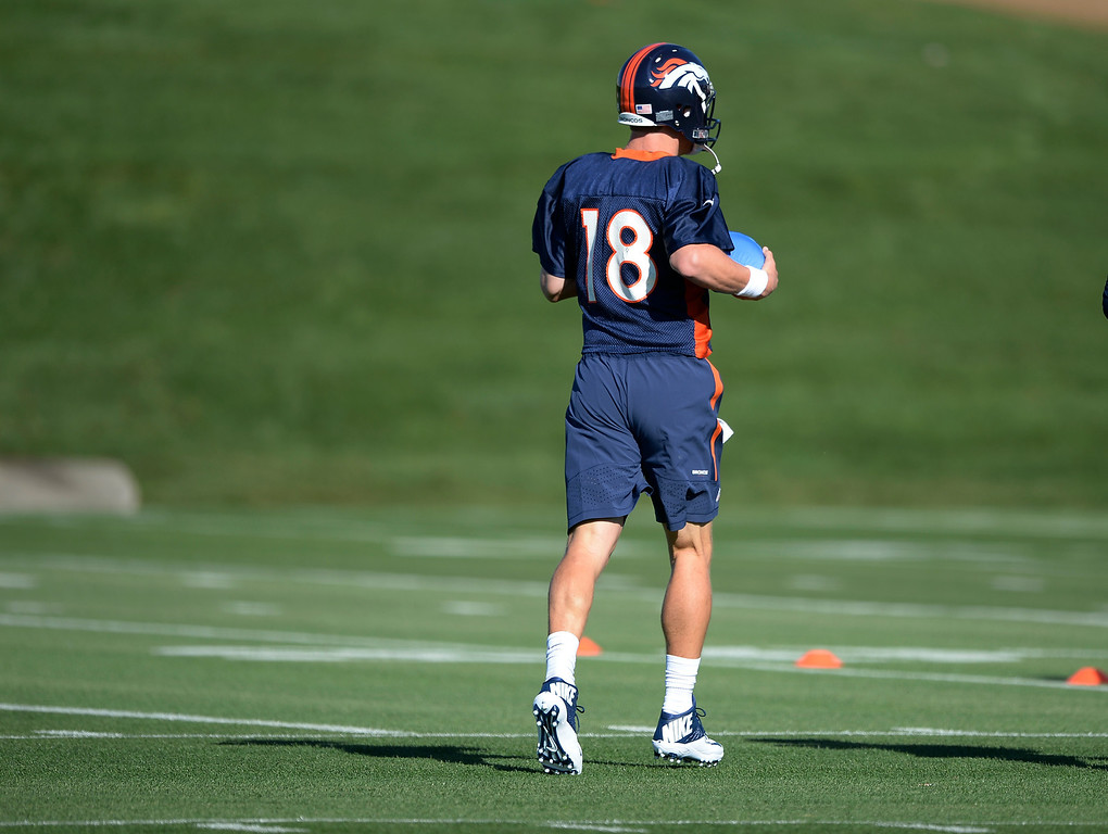 . Denver Broncos quarterback Peyton Manning (18) heads to the field for the start of the Denver Broncos 2014 training camp July 24, 2014 at Dove Valley. (Photo by John Leyba/The Denver Post)