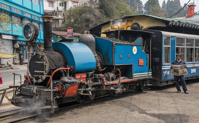 The Darjeeling Himalayan Railway in Darjeeling, West Bengal, India. The railway was built in 1881 with a track gauge of only 24 inches to cope with mountainous terrain. All equipment is correspondingly miniaturized.