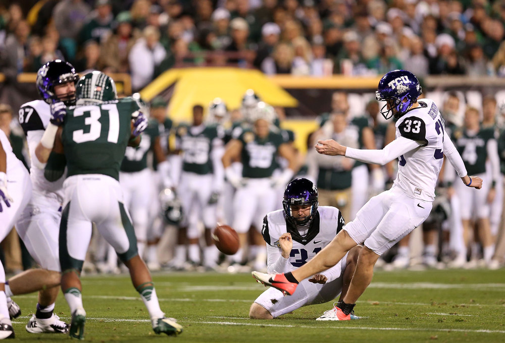 Description of . Kicker Jaden Oberkrom #33 of the TCU Horned Frogs kicks a second quarter field goal against the Michigan State Spartans during the Buffalo Wild Wings Bowl at Sun Devil Stadium on December 29, 2012 in Tempe, Arizona.  (Photo by Christian Petersen/Getty Images)
