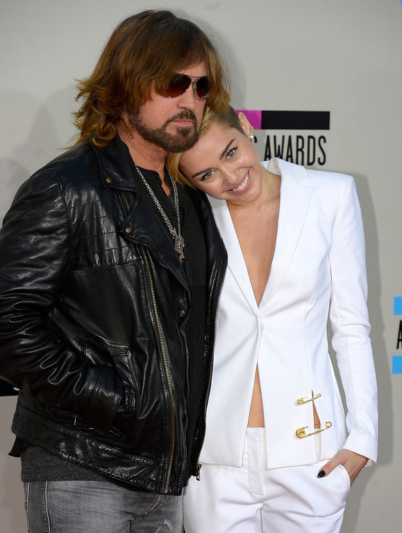 . Billy Ray Cyrus and Miley Cyrus arrives to the American Music Awards  at the Nokia Theatre in Los Angeles, California on Sunday November 24, 2013 (Photo by Andy Holzman / Los Angeles Daily News)