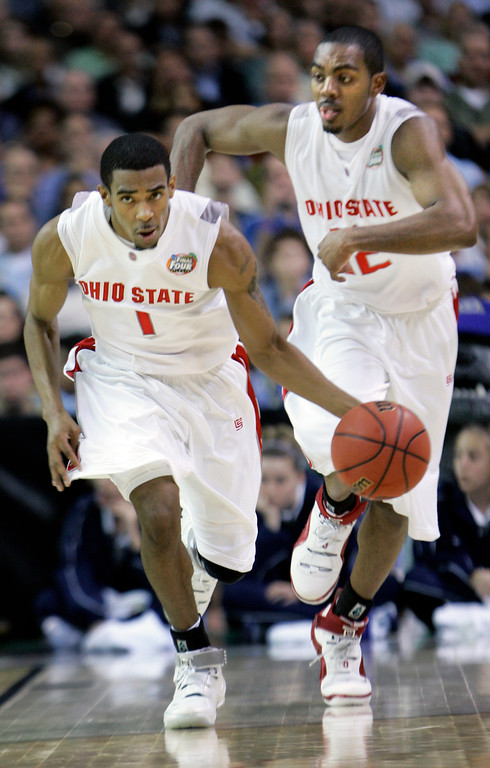 . Ohio State guard Mike Conley Jr. (1) and Ron Lewis (12) start the fast break in the second half of their men\'s semifinal basketball game at the Final Four in the Georgia Dome in Atlanta Saturday, March 31, 2007. Conley was high scorer for Ohio State in their 67-60 victory over Georgetown. (AP Photo/Gerry Broome)