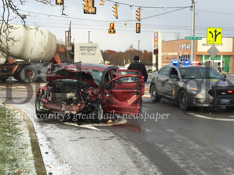State police investigate a crash Saturday morning between a cement truck and car on Route 8 in front of the Clearview Mall in Center Township that injured a woman and caused fuel to spill from the truck. 3 col. ONLY