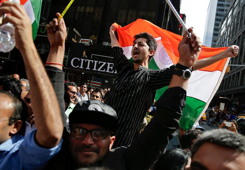 . Supporters of Indian Prime Minister Narendra Modi shout slogans as they watch a live stream on a screen in Times Square of Modi\'s speech from Madison Square Garden, Sunday, Sept. 28, 2014, in New York. Exhibiting unusual glitz for a visiting leader,  Modi took a star turn at the famous New York auditorium as he courted the Indian-American community on his first U.S. visit since sweeping to power in May. (AP Photo/Julie Jacobson)