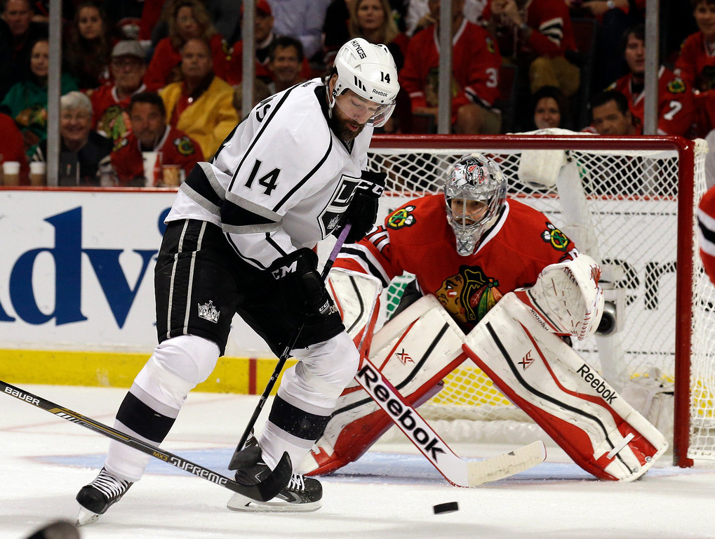 . Los Angeles Kings right wing Justin Williams (14) attempts to shoot against Chicago Blackhawks goalie Corey Crawford (50) during the first period in Game 7 of the Western Conference finals in the NHL hockey Stanley Cup playoffs Sunday, June 1, 2014, in Chicago. (AP Photo/Nam Y. Huh)