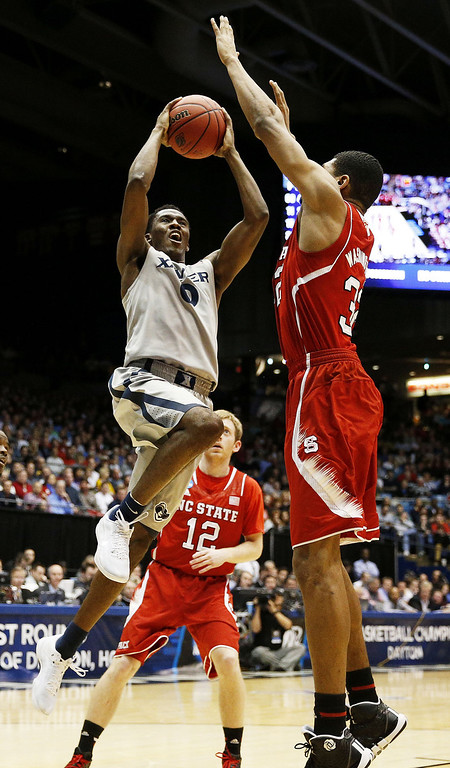 . Semaj Christon #0 of the Xavier Musketeers shoots against Kyle Washington #32 of the North Carolina State Wolfpack in the first half during the first round of the 2014 NCAA Men\'s Basketball Tournament at at University of Dayton Arena on March 18, 2014 in Dayton, Ohio.  (Photo by Gregory Shamus/Getty Images)