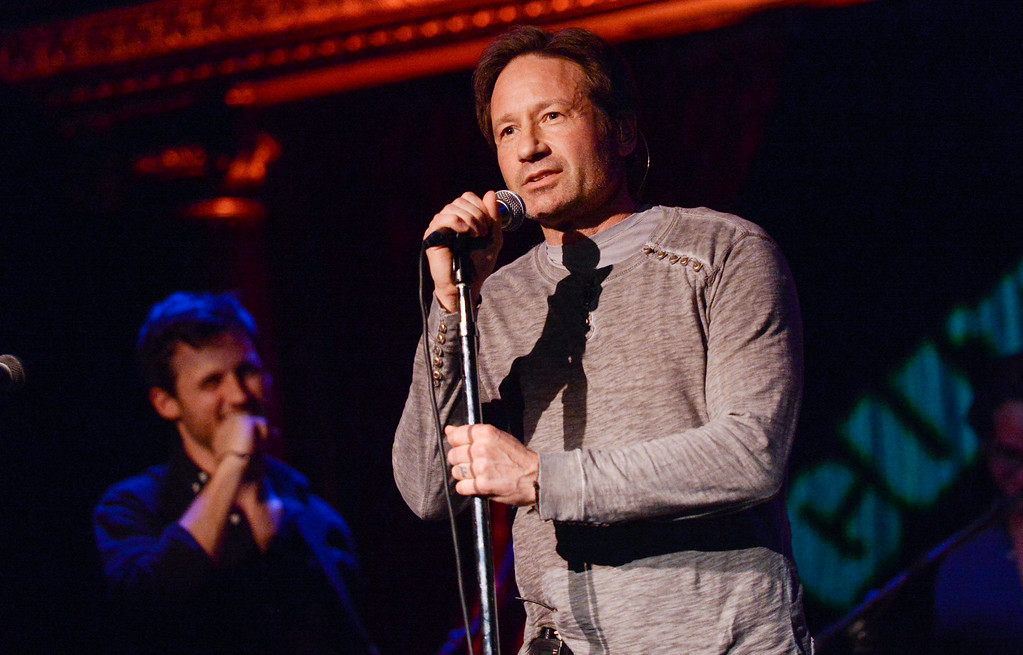 """. Actor and singer David Duchovny performs at The Cutting Room, in support of the release of his debut album \""""Hell Or Highwater,\"""" on Tuesday, May 12, 2015, in New York. (Photo by Evan Agostini/Invision/AP)"""