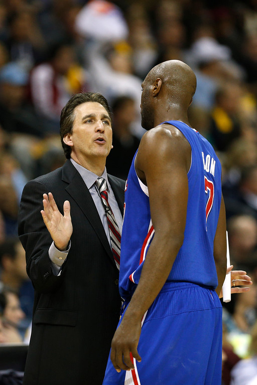 . Head coach Vinny Del Negro of the Los Angeles Clippers talks with Lamar Odom #7 during Game Six of the Western Conference Quarterfinals of the 2013 NBA Playoffs against the Memphis Grizzlies at FedExForum on May 3, 2013 in Memphis, Tennessee.   (Photo by Joe Robbins/Getty Images)