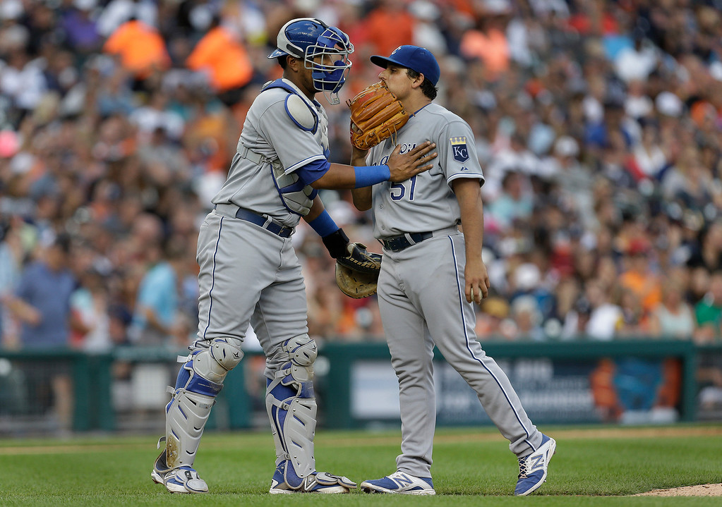 . Kansas City Royals catcher Salvador Perez, left, talks with pitcher Jason Vargas against the Detroit Tigers in the third inning of a baseball game in Detroit, Monday, June 16, 2014.  (AP Photo/Paul Sancya)