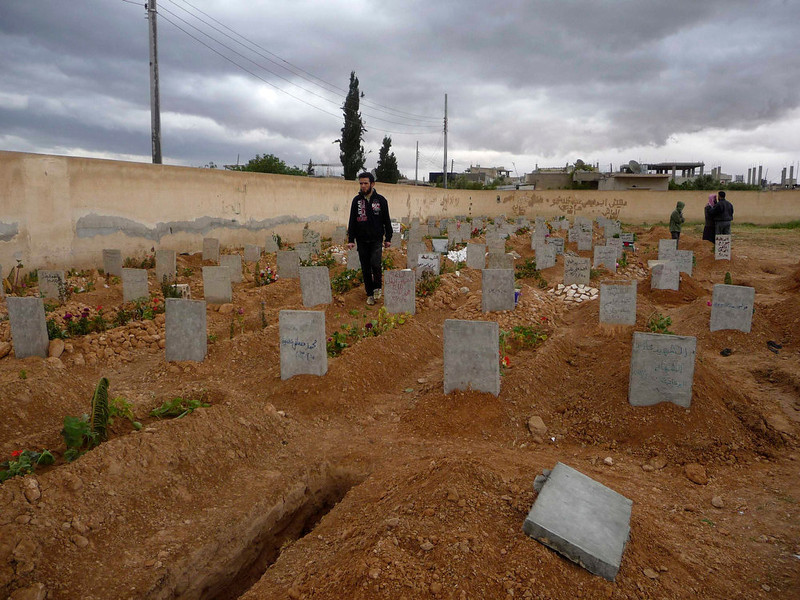 . Men visit the graves of people whom activists say were killed by shelling by forces loyal to Syria\'s President Bashar al-Assad, at a cemetery in Qusair town near Homs April 20, 2013. Picture taken April 20, 2013. REUTERS/Mohanad Mhebeddine/Shaam News Network/Handout