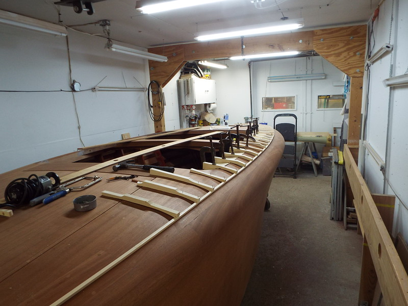 Rear view of the batten being held in place so the outside seam can be routed. Jigs are made so no brad holes are put in the deck.