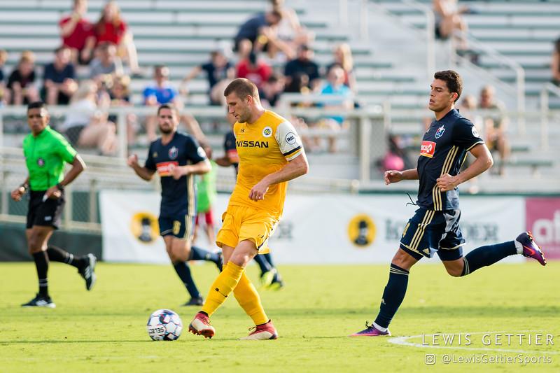 Nashville SC defender Justin Davis (2) and North Carolina FC forward Daniel Rios (14)