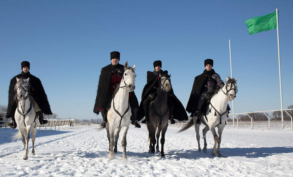 . A handout picture taken during the Sochi 2014 Winter Olympic torch relay  on February 3, 2014, and released by the Sochi 2014 Winter Olympics Organizing Committee shows the horsemen wearing traditional costumes of Russia\'s North Caucasus riding to welcome the Olympic flame in Maykop, the capital city of the Republic of Adygea. Russian torchbearers has started in October 2013 the history\'s longest Olympic torch relay ahead of Winter Games in Sochi, which will take the flame across the country through all 83 of its regions, including extreme locales such as Chukotka, the remote region in Russia\'s Far East, the turbulent North Caucasus, and even Russia\'s European exclave Kaliningrad.  AFP PHOTO / SOCHI 2014 ORGANIZING COMMITTEE/AFP/Getty Images