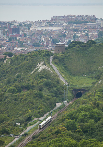 Southeastern Trains 377 between Dover and Folkestone is about to plunge into Martello Tunnel.