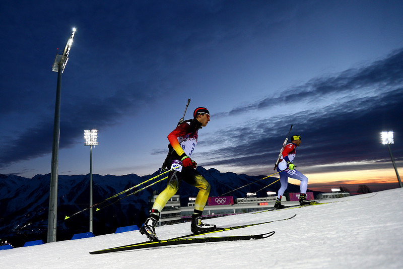 . Arnd Pfeiffer (L) of Germany and Milanko Petrovic of Serbia compete in the Men\'s Sprint 10 km during day one of the Sochi 2014 Winter Olympics at Laura Cross-country Ski & Biathlon Center on February 8, 2014 in Sochi, Russia.  (Photo by Clive Mason/Getty Images)
