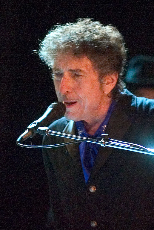 . FILE - In this Aug. 26, 2006 file photo, Bob Dylan performs as the opening act of the Pawtucket Arts Festival at McCoy Stadium, in Pawtucket, R.I. Rock legend Bob Dylan was treated like a complete unknown by police in a New Jersey shore community when a resident called to report someone wandering around the neighborhood. Long Branch business administrator Howard Woolley says a 24-year-old police officer apparently was unaware of who Dylan is and asked him for identification.   (AP Photo/Stew Milne, File)