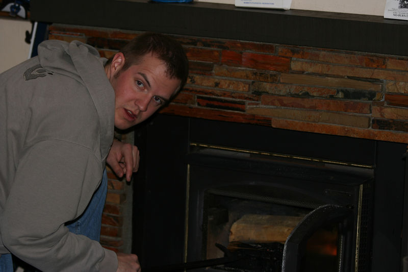 cole tending to the fire.jpg
