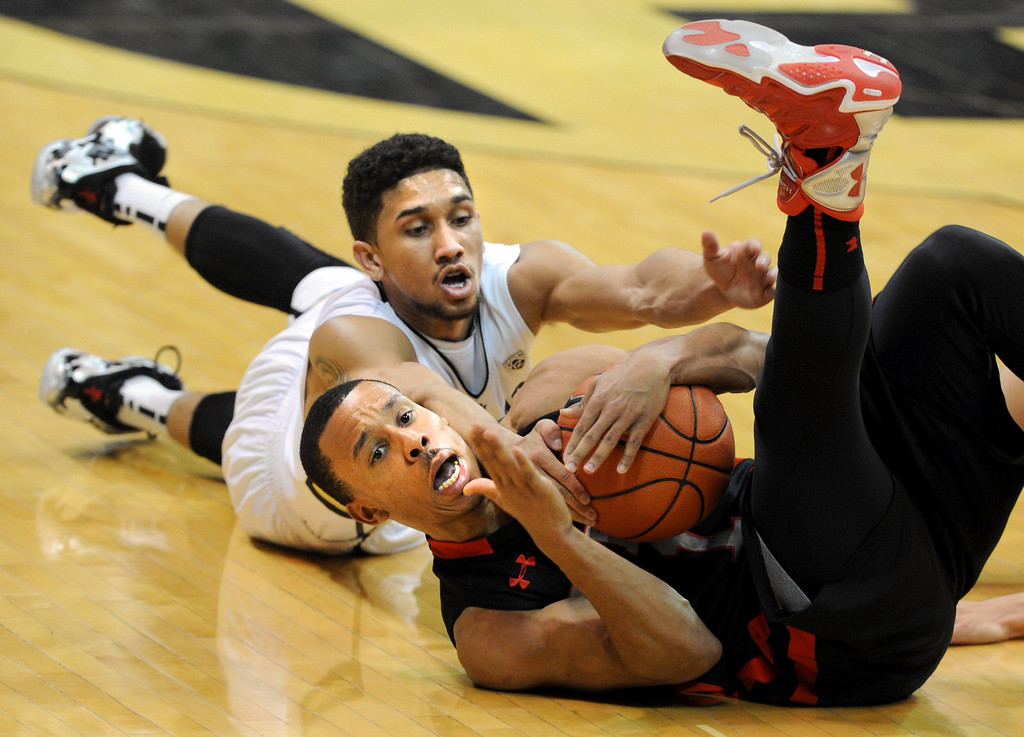 . Brandon Taylor of Utah tries to call a timeout before Askia Booker of Colorado can get to the ball during the second half of the February 21st, 2013 game in Boulder. For more photos of the game, go to www.dailycamera.com. Cliff Grassmick / February 21, 2013