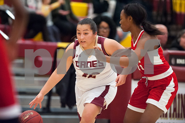 12/29/17 Wesley Bunnell | Staff New Britain basketball was defeated by visiting Wilbur Cross 56-28 on Friday evening at New Britain High School. Gabby Roy (42).