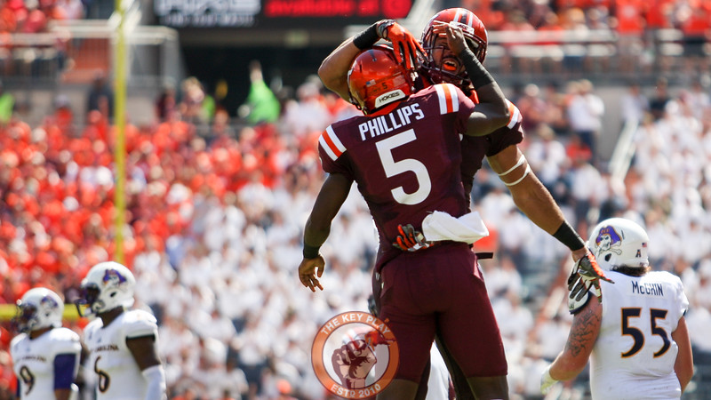 Cam Phillips and Bucky Hodges celebrate their punt block after the Hokies recover the ball. (Mark Umansky/TheKeyPlay.com)