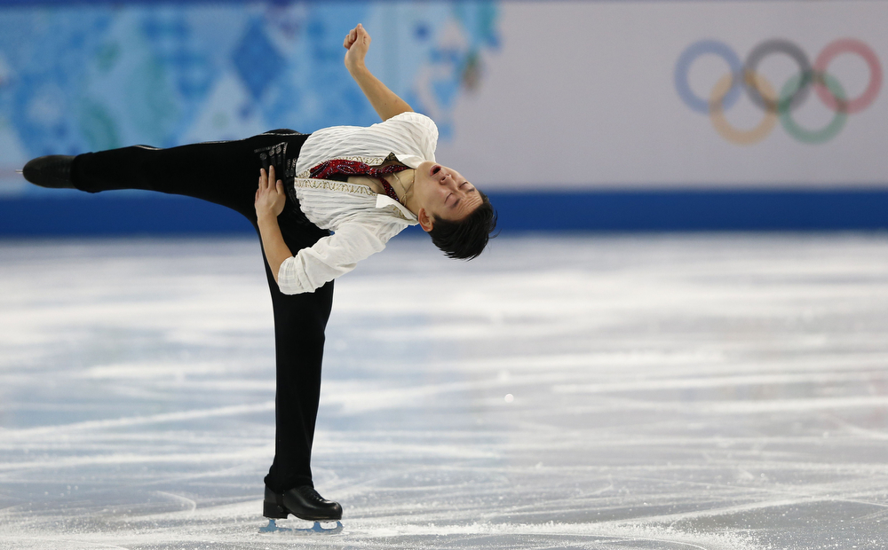 . Kazakhstan\'s Denis Ten performs in the Men\'s Figure Skating Free Program at the Iceberg Skating Palace during the Sochi Winter Olympics on February 14, 2014.    (ADRIAN DENNIS/AFP/Getty Images)