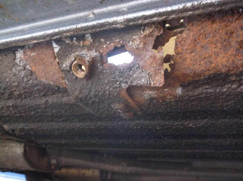 Right hand seatbelt mounting rotted-out. Dangerous and MoT fail