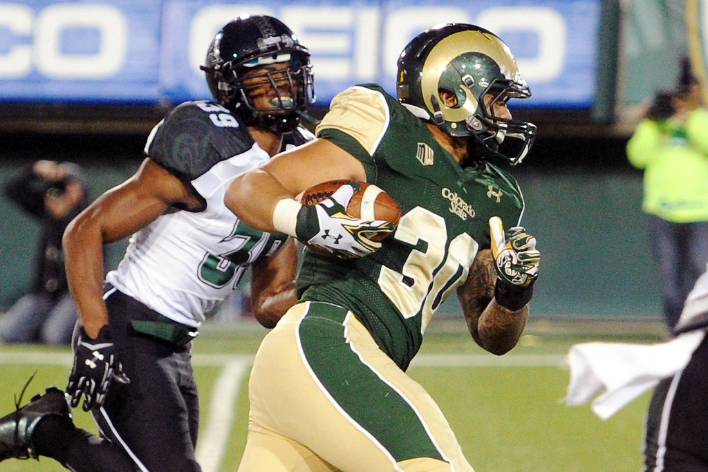 . 1109 SPO CSU football_05-srs.jpg Colorado State tight end Steven Walker (30) runs after a catch for a touchdown in front of Hawaii defensive back Trayvon Henderson in the second quarter Saturday, Nov. 8, 2014, at Hughes Stadium. (Photo by Steve Stoner/Loveland Reporter-Herald)