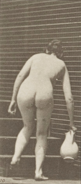Nude woman turning to ascend stairs