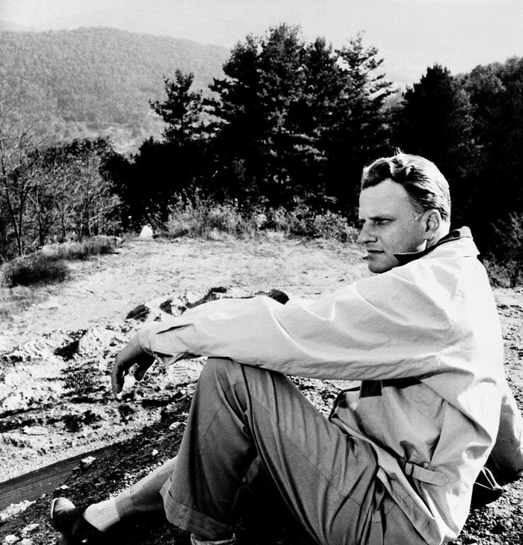 . Evangelist Billy Graham relaxes at his mountainside home near Montreat, N.C., May 1, 1957,   (AP Photo)