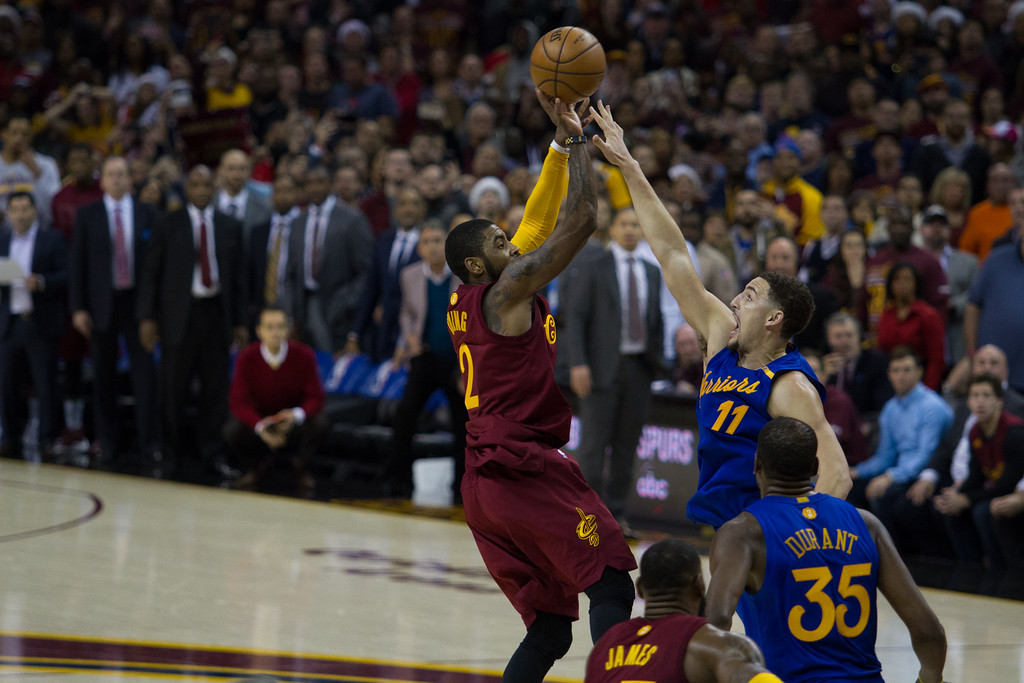 . Kyrie Irving (2) of the Cleveland Cavaliers takes a shot over Klay Thompson (11) to take the lead in the fourth quarter during an NBA game at the Quicken Loans Arena on Christmas day.  The Cavs defeated the Warriors 109-108.  Michael Johnson - The News Herald