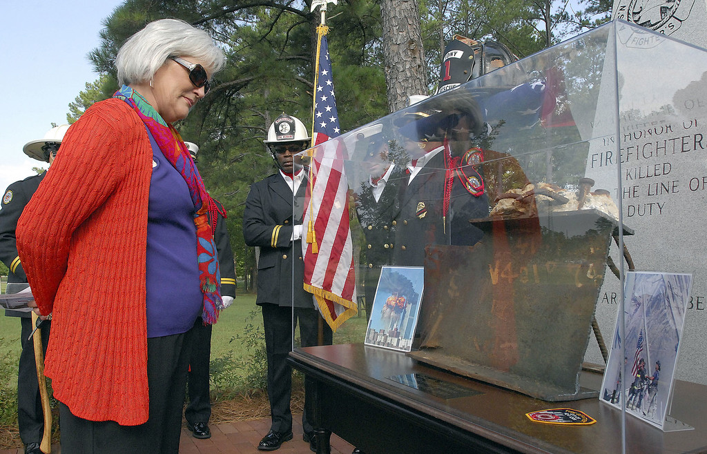 . In this Monday, Sept. 12, 2011 file photo, Cookie Bell, wife of Mississippi State Fire Academy Executive Director Reggie Bell, looks as a display with a salvaged section of the World Trade Center after it\'s unveiling during a 9/11 memorial ceremony at the academy in Pearl, Miss. �History is a vague concept, but if you have this tangible object that was a part of this historical event, it makes it very difficult to deny and it also makes it possible to experience it in a very visceral way,� says Harriet Senie, a professor of art history at the City University of New York and author of �Memorials to Shattered Myths: Vietnam to 9/11.� (AP Photo/The Clarion-Ledger, Rick Guy)