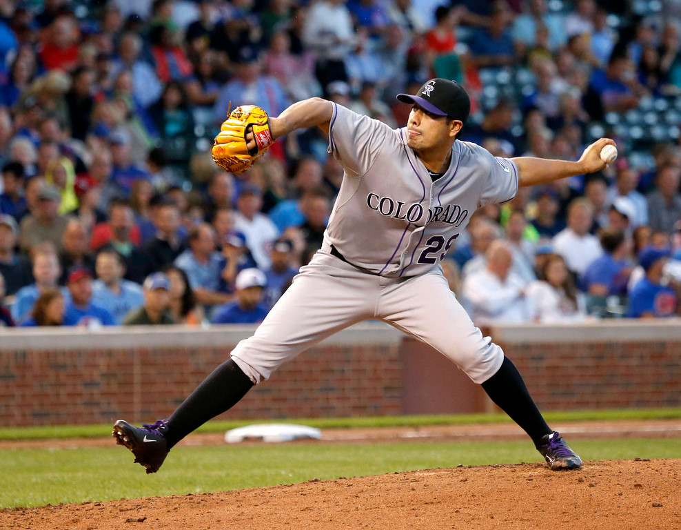 . Colorado Rockies starting pitcher Jorge De La Rosa delivers during the first inning of a baseball game against the Chicago Cubs, Tuesday, July 29, 2014, in Chicago. (AP Photo/Charles Rex Arbogast)