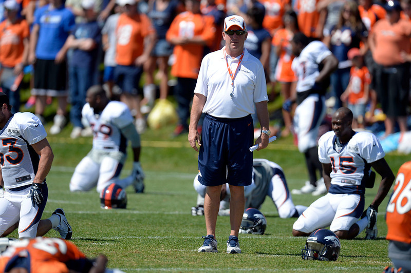 . Denver Broncos head coach John Fox looks on as the  team stretches during training camp August 12, 2013 at Dove Valley. (Photo By John Leyba/The Denver Post)