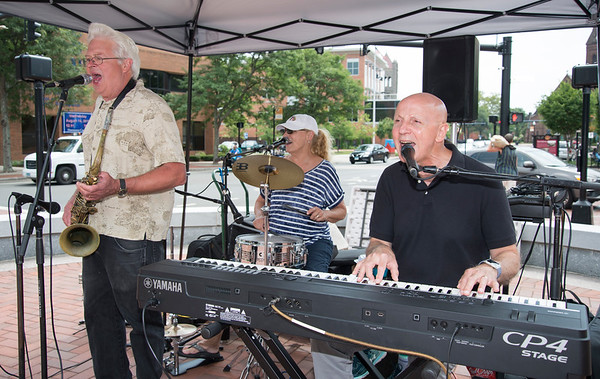 08/13/19 Wesley Bunnell | Staff The Bill Holloman Trio perform for visitors to the New Britain farmers market on Wednesday August 14, 2019 at Central Park.