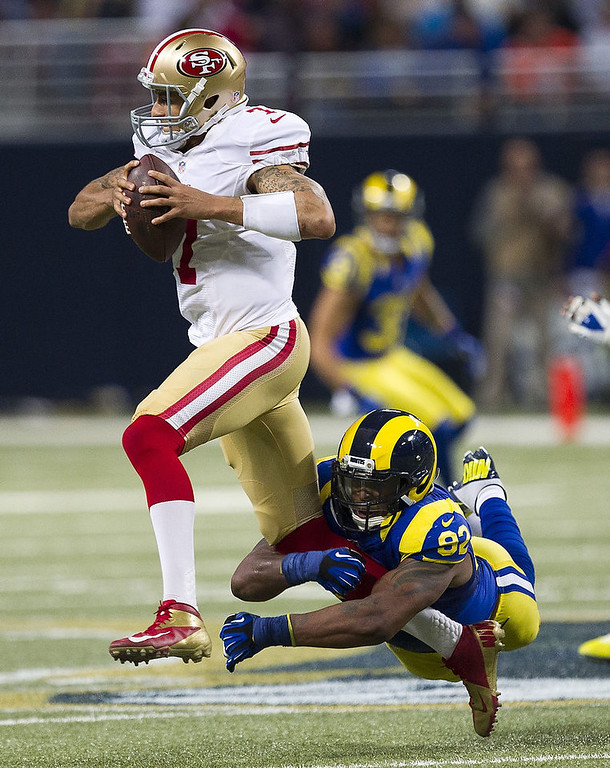 . Defensive end Eugene Sims #92 of the St. Louis Rams sacks quarterback Colin Kaepernick #7 of the San Francisco 49ers during the game at the Edward Jones Dome on December 02, 2012 in St. Louis, Missouri. (Photo by David Welker/Getty Images)